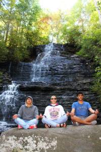 Meditating in Front of Waterfall